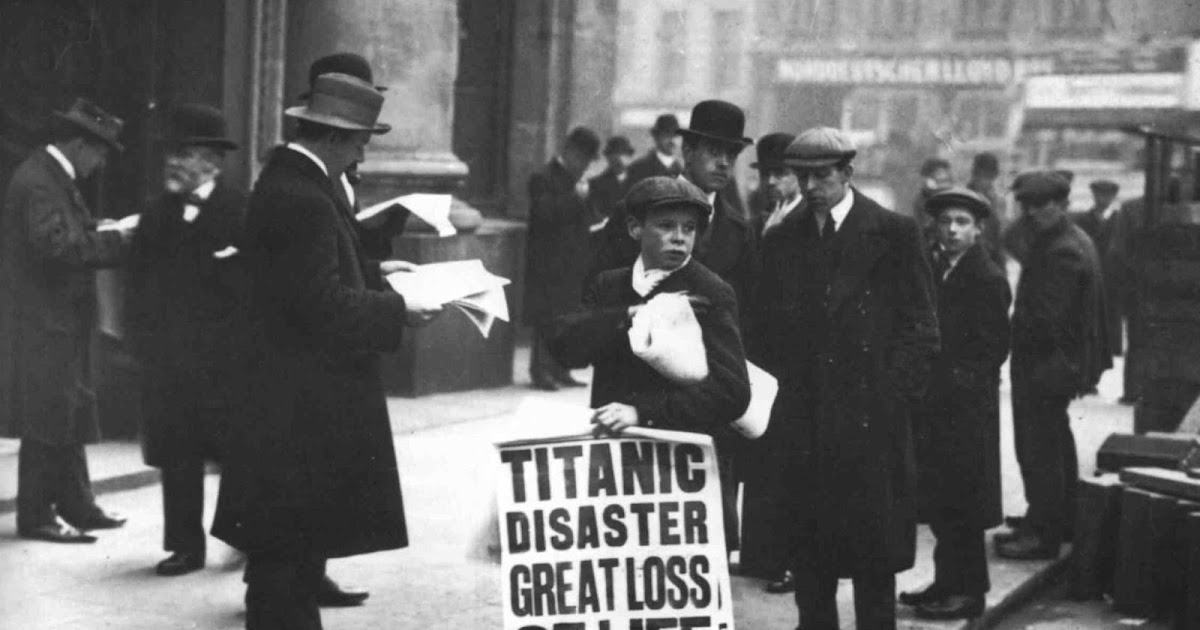 Boy holding a newspaper with the latest news about the disaster of the Titanic, 1912